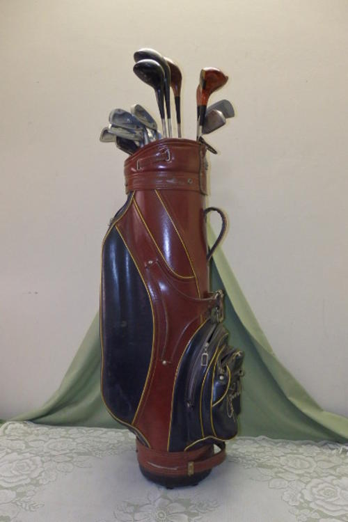 An Awesome Vintage Golf Club Set Including Woods And Irons In A Vintage Vinyl Joe Powell Bag