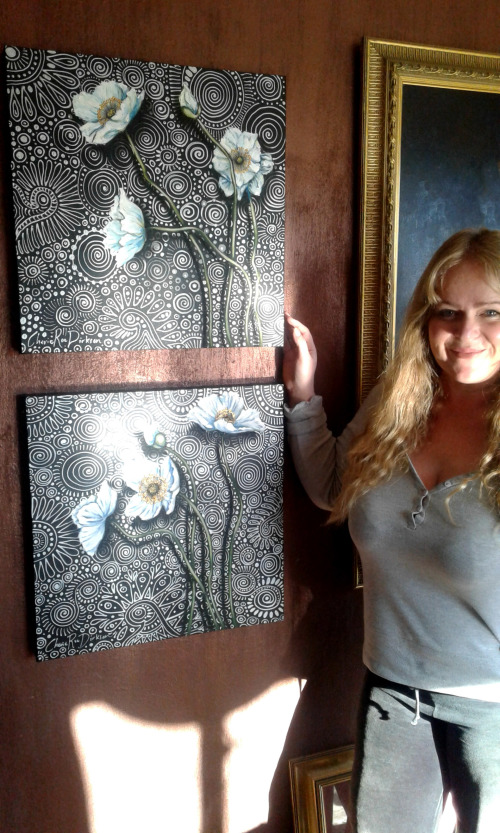 Cherie Roe Dirksen with her paintings
