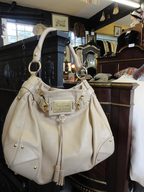 Original Car Shoe Beige Leather Handbag Good Condition Is A Quality Brand Owned By Prada