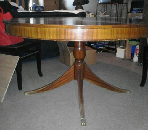 Tables round dining table with brass claw feet was sold for 10 foot round table