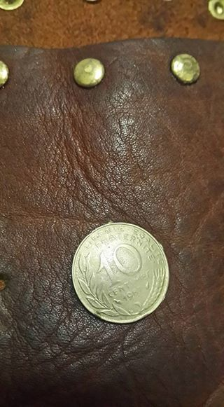 "One ""coin"" missing right at the back centre"