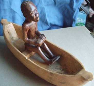African handcrafted carved wooden figure in rowing boat arts craft oar africa ornament antique man home decor   decoration collect collector edition collection must have bid buy now closing soon stock last one only   Birthday christmas new year holiday fathersday mothersday anniversary gift present Display amazing beautiful   wow want brown wood tribe Carzy tuesday wacky wednesday snap friday special weekend auction cheap low price   bargain sale