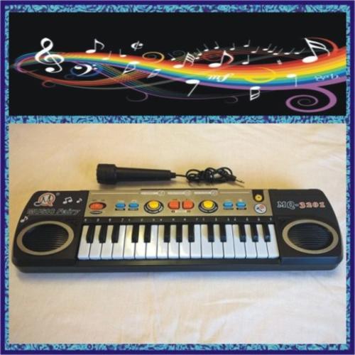 ELECTRONIC KEYBOARD - 32 KEYS - 3 Tones Select, 8 Rhythm Select, Sound  Effect, Volume Control  WOW!!