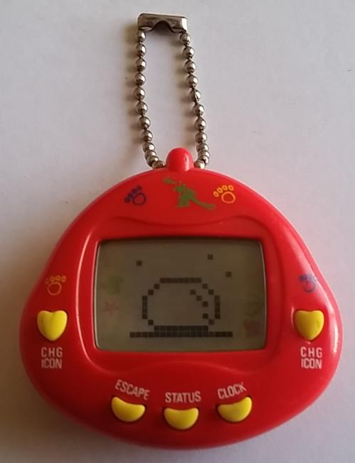 Other Toys - Vey Rare 90's Tamagotchi(Dinkie Dino Red) was ...
