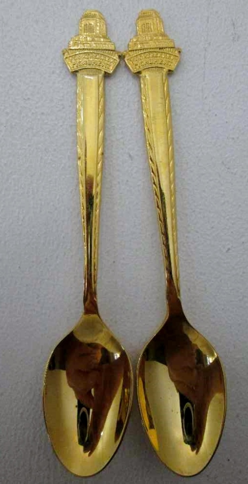 A Pair Of Gold Coloured Commemorative Vootrekker Monument Teaspoons - Length 13cm