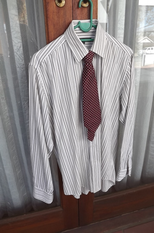 82cd566f560e Back and white striped long sleeve shirt in 100% cotton by OAKRIDGE in size  M.No pockets.Can wear casual with roll up sleeves or formal with included  tie.