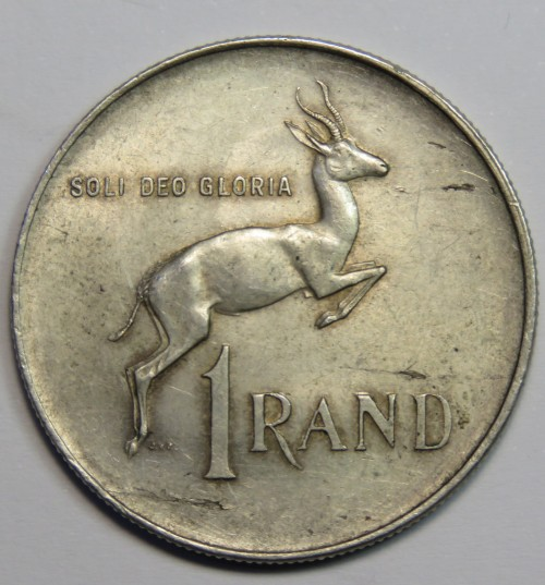 1966 silver 1 rand with 3 metal flaws