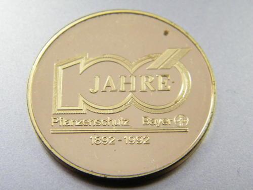 Bayer 100 year medallion in plastic holder