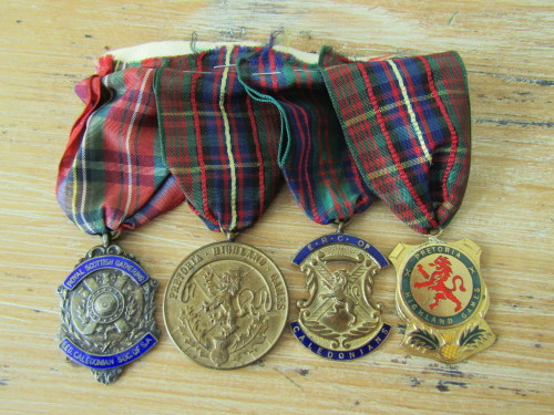 Set of 4 Caledonian Society Medals with ribbons, one in silver
