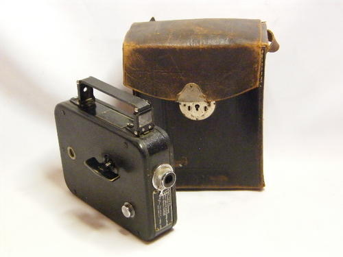 Vintage Cine-kodak Eight Model 20 movie Camera in leather case, loose stitching, as per photo