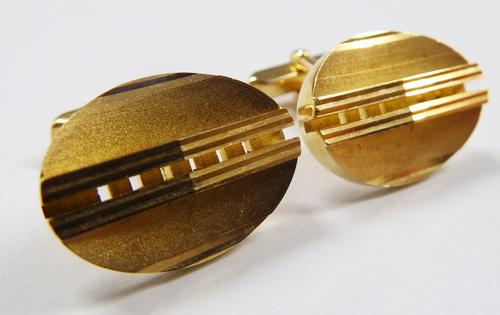 Pair of Gold coloured cufflinks - as per photo
