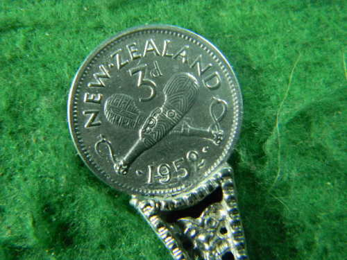 New Zealand 3d 1952 with New Zealand one penny 1945 spoon have marks on  spoon edge