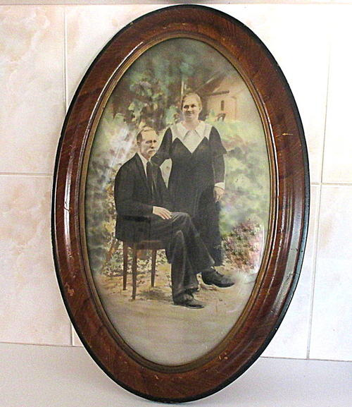 Frames & Mirrors - A LARGE ANTIQUE OVAL FRAME WITH CONVEX ...