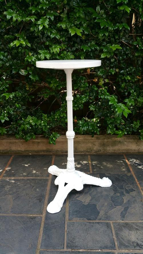 A Victorian Cast Metal Based Table with Wooden Top