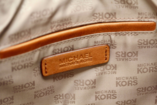 cb2361949f29 GORGEOUS MICHAEL KORS BEIGE CANVAS TOTE BAG WITH NAVY AND RED FABRIC  ACCENTS AND TAN LEATHER STRAPS Top end designer handbags are a wardrobe  item few of us ...