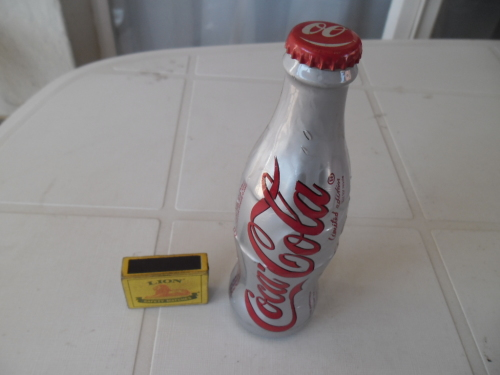 Full coca cola bottle size is 190mm high ordinary postage is R50 see  condition