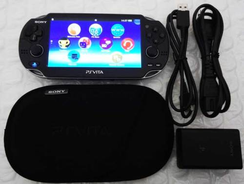 Consoles - SONY PLAYSTATION VITA WITH 4GB MEMORY CARD + PROTECTIVE