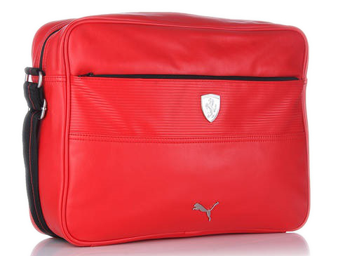 """a02fee048260 Brushed silver metal PUMA Cat Logo on the front. Internal """"10th  anniversary"""" label celebrating the long-term partnership Ferrari x PUMA  Colour  Red"""