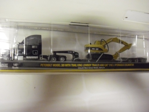 Peterbilt Model 389 With Rail King Lowboy Trailer and CAT 315CL Hydraulic  Excavator