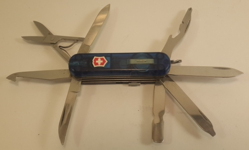 8112e098fdb Victorinox - Blue Mini Champ Midnite MiniChamp replaces the tweezers with a  small white LED light activated by pushing on the Victorinox shield which  is ...
