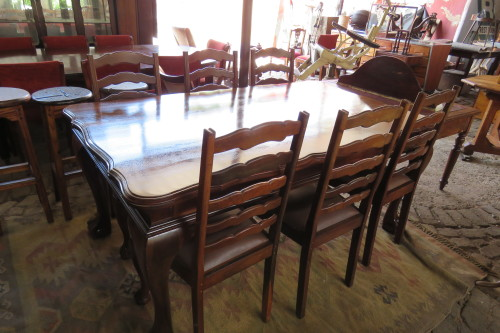 A LARGE IMBUIA BALL AND CLAW 8 SEATER TABLE CHAIRS NOT INCLUDED