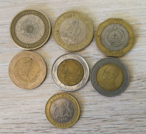 *Bulk Buy* 7 x world bi-metal coins - Pounds, Liras   escudos, rupees, pula