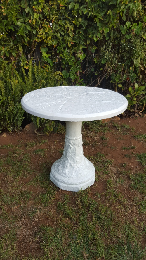 Beautiful round solid concrete garden table